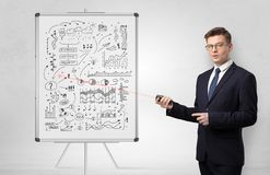 Professor on whiteboard teaching economy stock photography