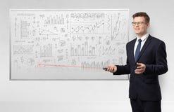 Professor on whiteboard teaching geometry. Professor with laser pointer teaching geometry stock image