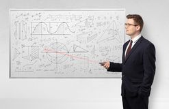 Professor on whiteboard teaching geometry stock images