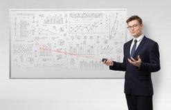 Professor on whiteboard teaching geometry. Professor with laser pointer teaching geometry royalty free stock photo