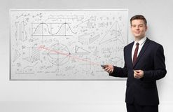 Professor on whiteboard teaching geometry. Professor with laser pointer teaching geometry stock photography