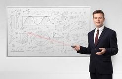 Professor on whiteboard teaching geometry royalty free stock photography