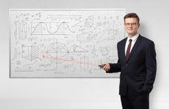 Professor on whiteboard teaching geometry royalty free stock image