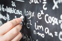 Professor writing mathematical formula and equation. To blackboard in school classroom. College or university teacher or student with chalkboard. Science stock photos