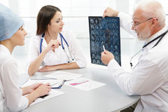 Professor and young doctors Royalty Free Stock Photo