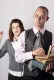 Professore fastidioso e ragazza teenager di età Immagine Stock