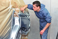 Proffesional car paint worker. Stock Photos