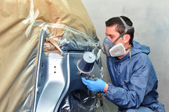 Proffesional car paint worker. Royalty Free Stock Images