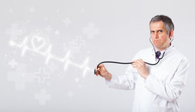 Doctor examinates heartbeat with abstract heart Royalty Free Stock Photos
