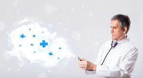 Doctor listening to abstract cloud with medical signs. Proffesional doctor listening to abstract cloud with medical signs Royalty Free Stock Photos