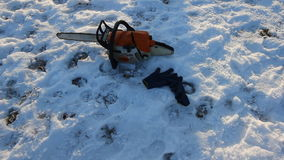 Proffesional Lumberjack hold hand saw. Winter wearing protection clothes using chainsaw. clean fallen trees stock video