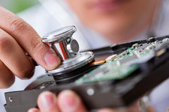 The proffesional repairman repairing broken hard drive Stock Image