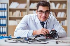 The proffesional repairman repairing broken hard drive Royalty Free Stock Photos