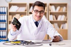 The proffesional repairman repairing broken hard drive Royalty Free Stock Photography