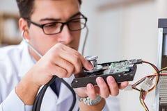 The proffesional repairman repairing broken hard drive Royalty Free Stock Images