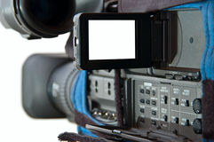 Proffesional Video Camera. Video camera over white with screen open-white space for images or text Stock Images
