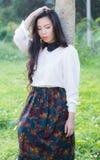 Profiel van een jonge Aziatische vrouw Stock Foto's