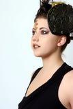 Profiel van een Vrouw met Wild Make-up en Haar Stock Foto