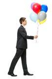 Profiel van het lopen met ballons de bedrijfsmens Royalty-vrije Stock Foto's