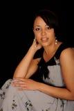 Profiel van vrouwenzitting Royalty-vrije Stock Foto's