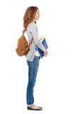 Profil av den lyckliga kvinnliga studenten som isoleras på vit Arkivbilder