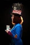 Profil av den unga kvinnan i similituden av hattmakaren Arkivfoto