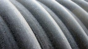 Profil av det spiral polyetheneröret med stålremsaförstärkningen Royaltyfri Fotografi
