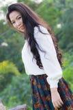 Profil av en ung asiatisk kvinna Arkivfoton