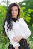 Profil av en ung asiatisk kvinna Royaltyfri Foto