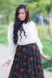 Profil av en ung asiatisk kvinna Arkivfoto