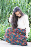 Profil av en ung asiatisk kvinnablick Royaltyfria Bilder