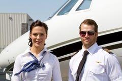 Profil av piloten och stewardessen Royaltyfria Foton