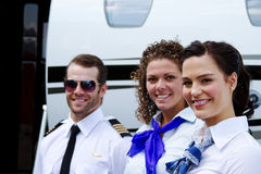 Profil av piloten och stewardesser Arkivfoto