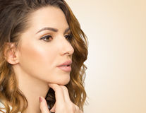 Profil of beautiful woman, close up studio on yellow background. Beauty female face with perfect make up. Youth and skin care concept Royalty Free Stock Images