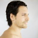 Profil d'un sourire beau d'homme Photographie stock libre de droits