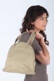 Profil de femme avec le sac photographie stock libre de droits