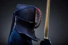 Profil de kendoka avec le shinai Photographie stock libre de droits