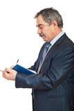 Profil de l'écriture mûre d'homme de busienss Images libres de droits