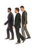 Profil de la marche d'hommes d'affaires Photographie stock