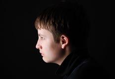 Profil du garçon triste Photos stock