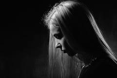 Profil triste de fille Photos libres de droits
