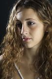 Profile. A profile shot of a demure and attractive young model Royalty Free Stock Photos