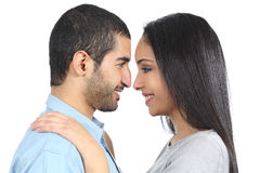 Profile of an arab couple looking each other royalty free stock image