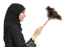 Profile of an arab woman cleaning with a duster clean stock photography