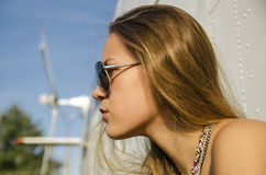 Profile attractive girl with long hair in sunglasses about helic Royalty Free Stock Photo