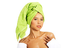 Profile of attractive woman wrapped in towel with turban. Royalty Free Stock Photo