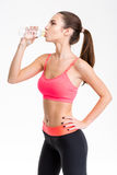 Profile of attractive young sportswoman drinking water Stock Photo