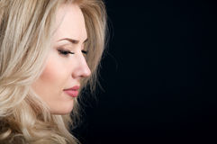 Profile of beautiful blonde with curly hair Royalty Free Stock Photography