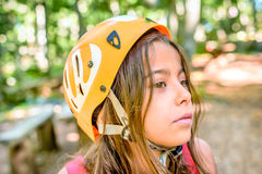 Profile of a beautiful eight year old girl in adventure park Stock Photos