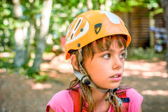 Profile of a beautiful eight year old girl in adventure park Royalty Free Stock Photography